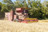 Combine Harvester in field — Stock Photo