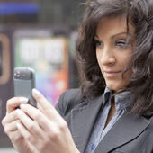 Woman photographing with cell phone — Stock Photo