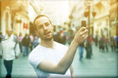 Man with smartphone take photo — Stock Photo