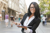 Woman With Tablet Computer On Street — Stock Photo