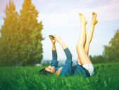 Young woman using mobile phone in park — Stock Photo