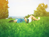 Young woman using mobile phone in park — Foto de Stock