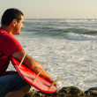 A surfer watching the waves — Stock Photo