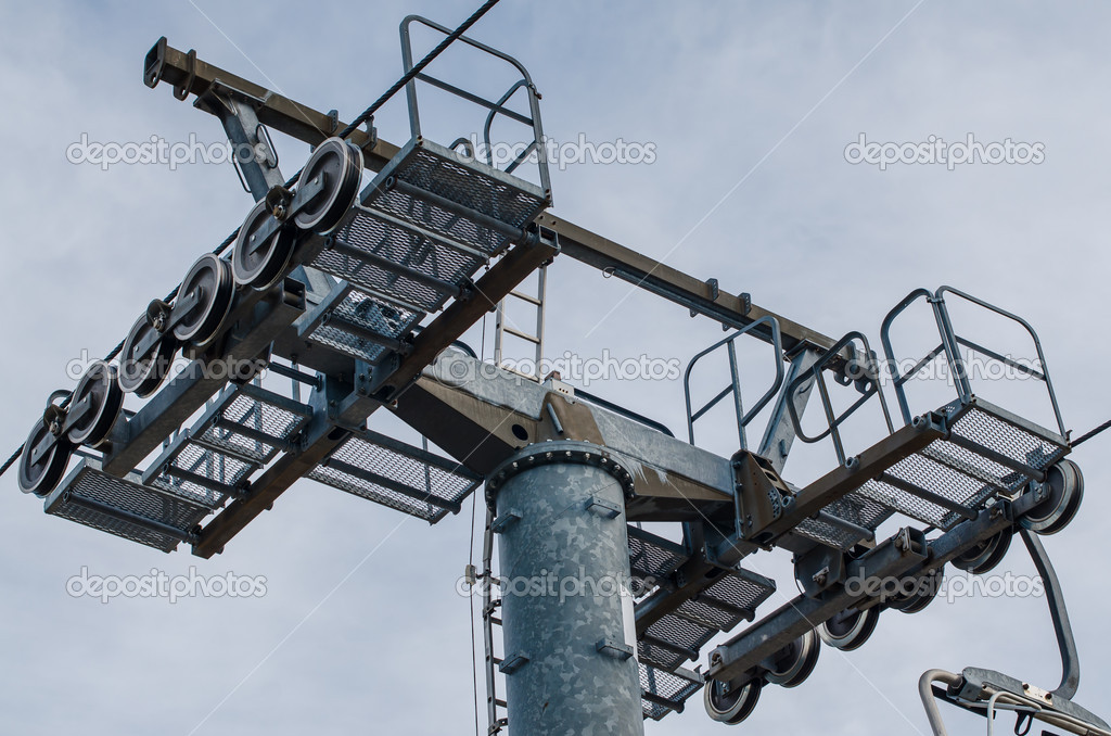 Mast of a chairlift, on cloudy sky.  Stock Photo #11090901