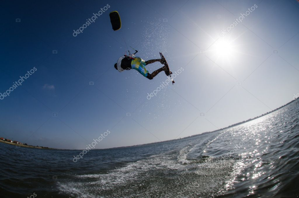 Kiteboarder flying over the water on a sunny day. — Stock Photo #11736161