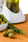 Green olives in a white ceramic bowl — Stock Photo