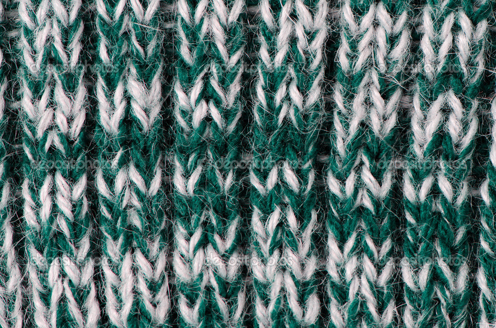 Knit woolen texture. Fabric green and white background. — Stock Photo #11978622