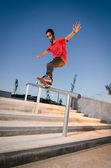 Skateboarder on rail — Stock Photo
