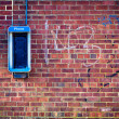 Grunge Brick wall with payphone — Stock Photo