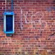 Stock Photo: Grunge Brick wall with payphone