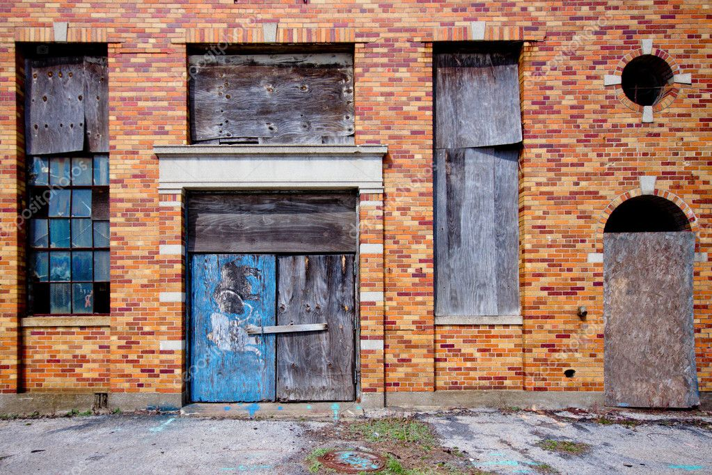 Boarded up abandoned industrial building — Stock Photo #10750594