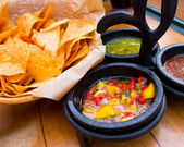 Nachos and salsa — Stock Photo