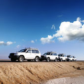 By jeeps with 4 deserts of Africa — Stock Photo