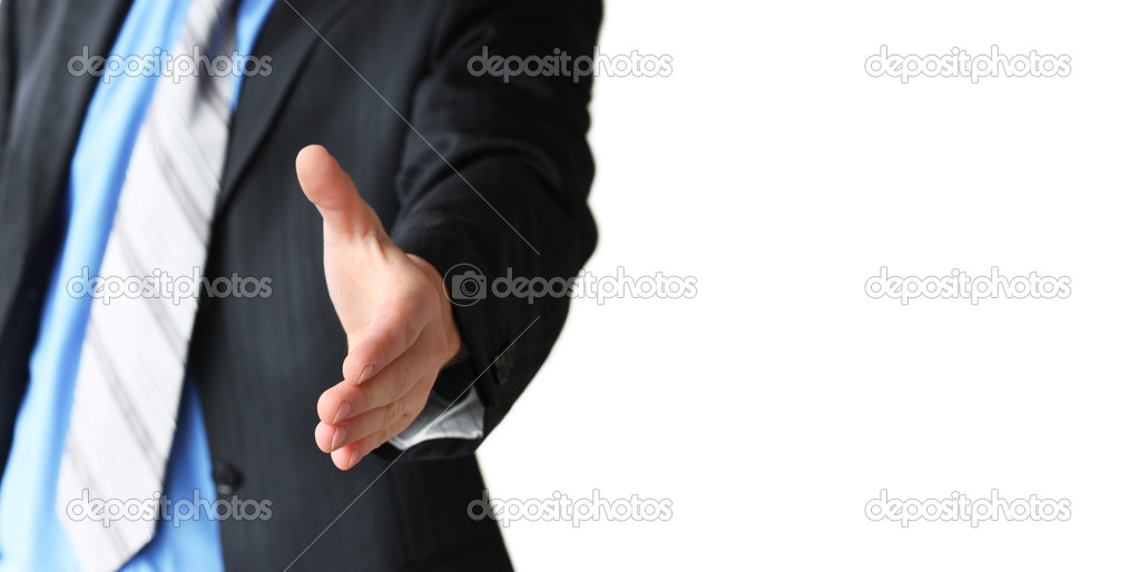 Young business man giving hand for handshake  Stock Photo #11048557