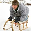 Stock Photo: Sledding at winter time