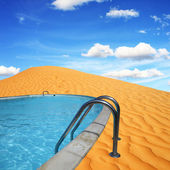 A dream to build a pool in the desert — Stock Photo