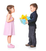 Little boy giving a gift box to her girlfriend — Stock Photo