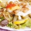Royalty-Free Stock Photo: Creative fresh salad from seafood and fried eggs