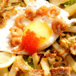 Creative fresh salad from seafood and fried eggs — Stock Photo