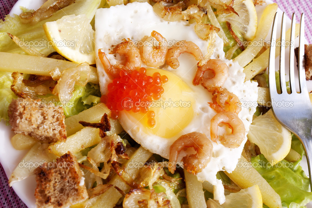 Creative fresh salad from seafood and fried eggs  Stock Photo #11017002