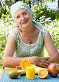 The adult woman and fruit — Stock Photo