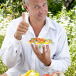 The man the vegetarian tastes salad - ストック写真