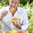 The man the vegetarian tastes salad — Stock Photo #11328811