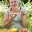 The adult woman eats salad - ストック写真