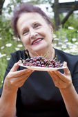 The happy smiling woman and cherry — Stock Photo