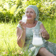 Royalty-Free Stock Photo: Seniors female drinks fresh milk