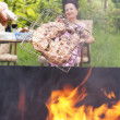 Appetizing  barbecue in a green summer garden — Stock Photo