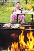Appetizing barbecue in a green summer garden — Stock Photo