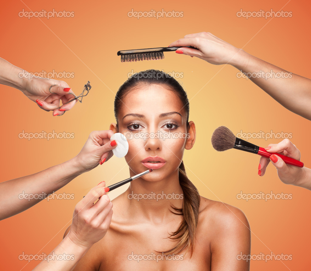 Conceptual beauty and fashion image of the hands of several beauticians and stylists holding their respective equipment giving a glamour makeover to a beautiful woman — Stock Photo #10922532
