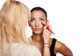 Makeup artist applying makeup to her model — Stock Photo