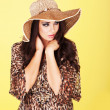 Beautiful brunette in straw hat — Stock Photo #11349939