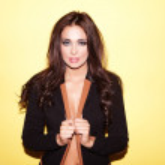Beautiful brunette in stylish jacket — Stock Photo #11350017