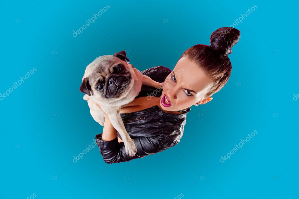 Woman with a pug dog wearing lether jacket — Stock Photo #11535090