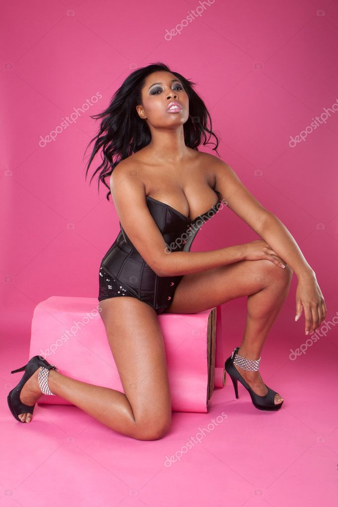Sexy woman on pink wearing corset — Stock Photo #11535093