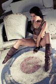 Sexy woman on aeroplane fuselage — Stock Photo