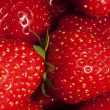 Stock Photo: Background of luscious ripe red strawberries