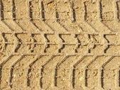 Motor vehicles traces on the sand. — Stock Photo