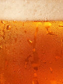Beer with foam in cool glass taken closeup. — Stock Photo