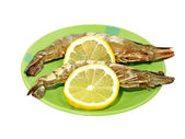 Two shrimps and lemon. — Stock Photo