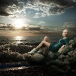 Beautiful Blonde Woman Sitting near the Sea — Stok fotoğraf