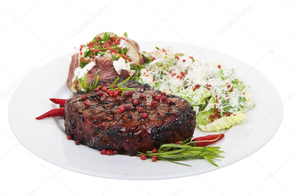 A tenderloin steak dinner isolated on white background — Stock Photo #11369587