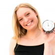 Woman holding a clock — Stock Photo