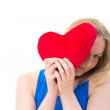 Woman holding a red heart - Stock fotografie