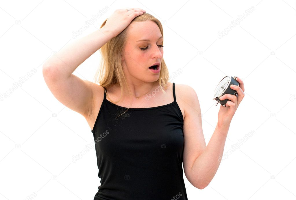 Shocked young beautiful woman holding a clock on a white background — Stock Photo #10858974