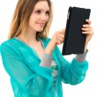 Woman holding in hand a tablet touch pad — Stock Photo #11599448