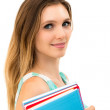 Smiling woman holding notebooks — Stock Photo
